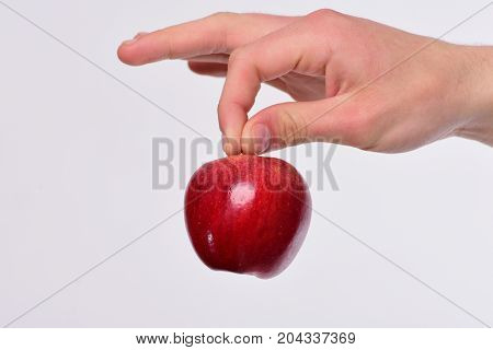 Male Hand Holds Red Apple. Apple Isolated On Light Grey