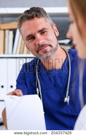 Male Medicine Doctor In Blue Uniform Hold And Give Prescription