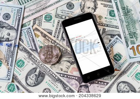 Dollars, Bitcoin And Mobile Phone. Cocept.