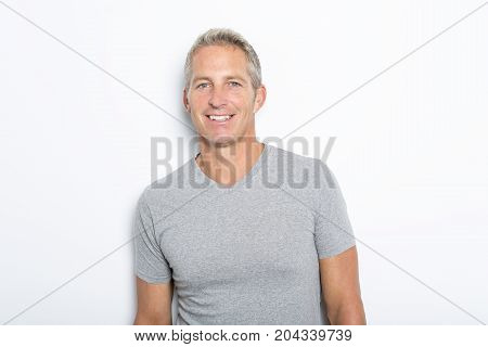 A Portrait of confident mature man standing on white background