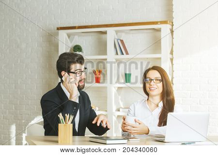 Cheerful Businessman And Woman Using Smartphone