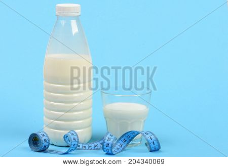 Calcium Nutrition And Healthy Diet. Milk In Transparent Containers