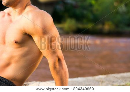 Man Doing Triceps Workout By The River