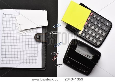 Calculator, Note Paper, Hole Punch And Paper Clips Opposite Organizer