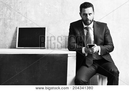 Job Interview, Businessman With Smartphone And Blackboard On Table
