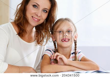 Blond Smiling Little Reading Together With Mom
