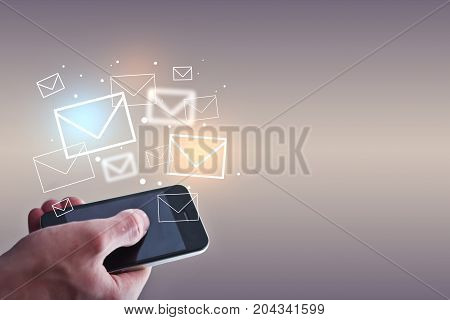 Businessman holding smartphone with emails on light background. Email marketing concept