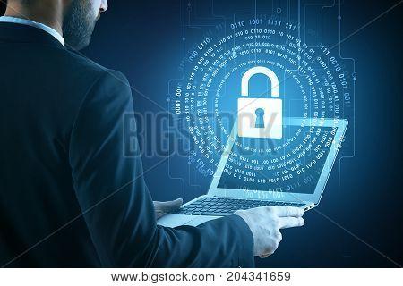 Side view of businessman using laptop with digital padlock hologram. Hacker concept