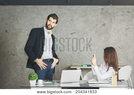 Young Caucasian Businessman And Woman Using Smartphone