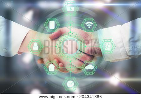 Side view and close up of handshake with abstract digital business network hologram. Teamwork and touchscreen concept. Double exposure