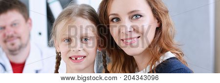 Little child with mother at pediatrician reception. Physical exam cute infant portrait baby aid healthy lifestyle ward round child sickness clinic test high quality and trust concept