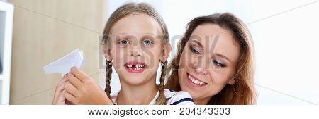 Blond Smiling Little Girl Make Paper Plane