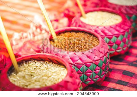 red rice purple bowl background whole grain rice various types of rice