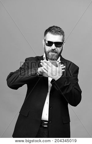 Man With Beard Holds Blue Business Cards Between Palms