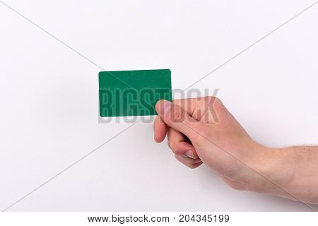 Advertising And Introducing Concept. Male Hand Holds Dark Green Card.