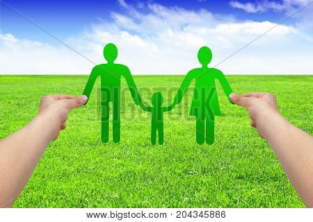 Hands hold paper family , eco concept