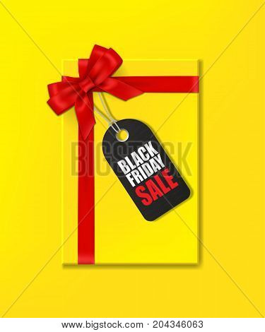 Vector Yellow gift box with red ribbon and bow and tag with Black Friday Sale text on yellow background.
