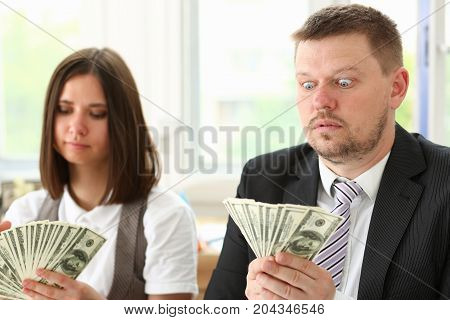 A Man And A Woman Enjoy Light Money In The Form Of Fraud