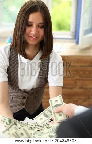 Businessman And Business Woman Counting Cash On The Table At The Office With Hands Very Many Dollars