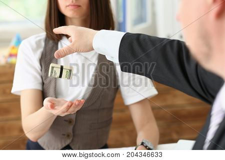 Businessman Gives A Cutlet From Money To A Woman In The Form Of A Salary Bribe In An Envelope Dollar