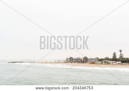 SWAKOPMUND NAMIBIA - JUNE 30 2017: The Molen and the Strand Hotel in Swakopmund in the Namib Desert on the Atlantic Coast of Namibia as seen from the historic jetty