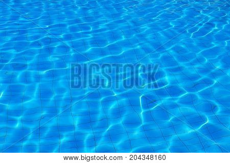 Blue water on the surface of the pool pattern background.