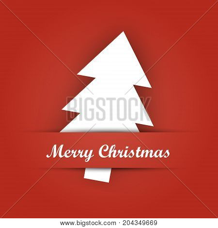 Christmas card paper pocket with white tree papercut and Merry Christmas label on red background.