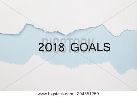 2018 GOALS under torn white paper. 2018 plan