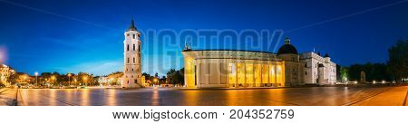 Vilnius, Lithuania, Eastern Europe. Evening Night Panorama Of Bell Tower Belfry, Cathedral Basilica Of St. Stanislaus And St. Vladislav And Palace Of The Grand Dukes Of Lithuania In Twilight. UNESCO