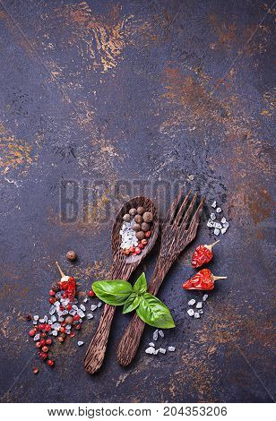 Fork and spoon with herbs and spices. Culinary background. Top view