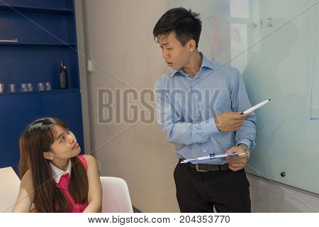 Young employee listen to her boss with concentration