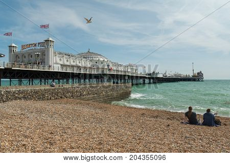 24 of August, 2017, Editorial photo of Brighton Pier and beach, Brighton, UK, Great Britain England