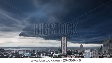 Heavy storm rainy clouds over modern city