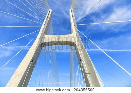 Prospective view of Vasco da Gama Bridge, the longest bridge in Europe, on Tagus River in a sunny day with blue sky. Lisbon city, Portugal.