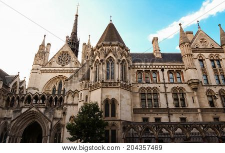 The historical building and entrance of Royal Courts of Justice in London, England.