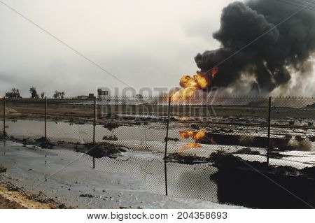 Oil Well Burning In Field Of Oil Slick, Kuwait