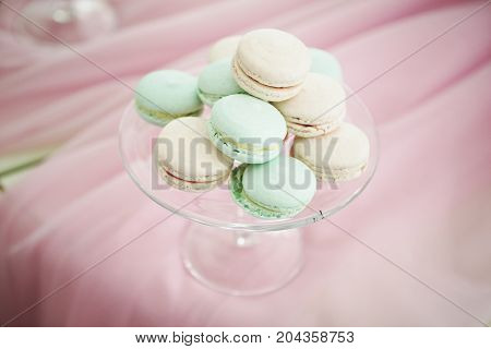 Gentle pastel colourful macaroons on pink soft background