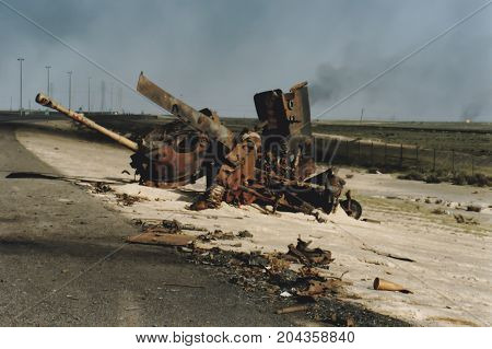Burned Shell Of Iraqi Tank On Side Of Road, Kuwait