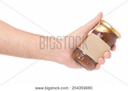 Male hand jar jam apricot on white background isolation
