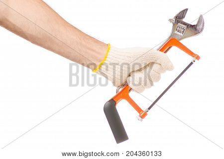 Male hand tools key hacksaw on white background isolation