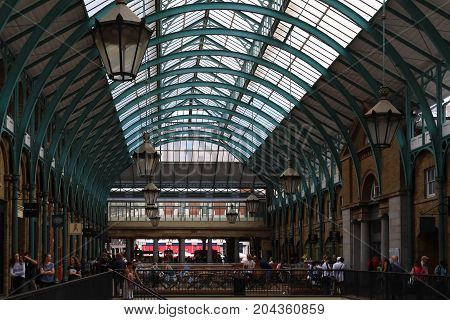 LONDON - UK - August 15, 2017: View of Covent Garden market in London. Covent Garden - one of the main tourist attractions in London - is known for its restaurants, pubs, market stalls and shops