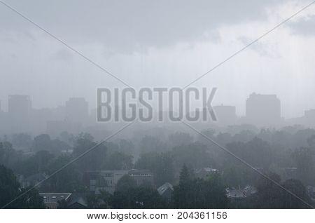 TORONTO - Aug 4 2014: Toronto cityscape panorama in rain storm. Ontario Canada