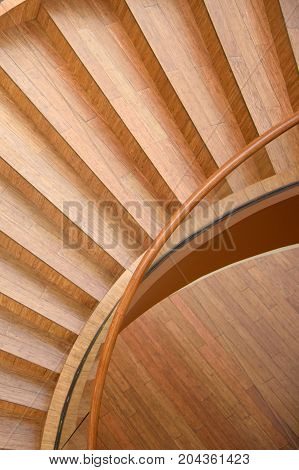 Abstract spiral staircase of the unusual shape - the top view. Fancy staircase in the shape of seashells. Design for interior home inside. The perspective and geometry of residential structures.