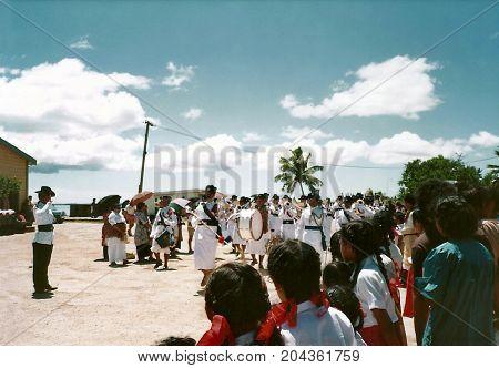 NUKU'ALOFA, TONGATAPU / TONGA - CIRCA 1990: A military band marches in a parade during a national holiday.