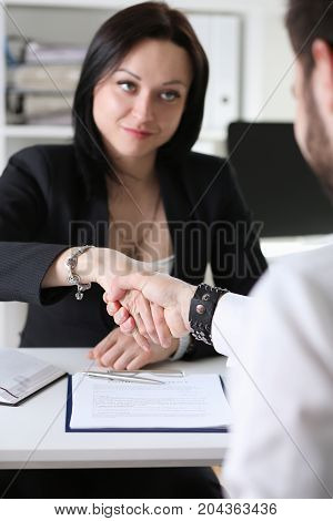 Businessman And Woman Shake Hands As Hello In Office