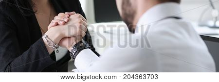 Woman And Man In Suit Hold Hands In Wrestle