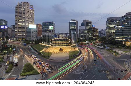 SEOUL SOUTH KOREA - AUGUST 7: Traffic at old fortress Namdaemun gate Photo taken on august 7 2017 in Seoul South Korea.
