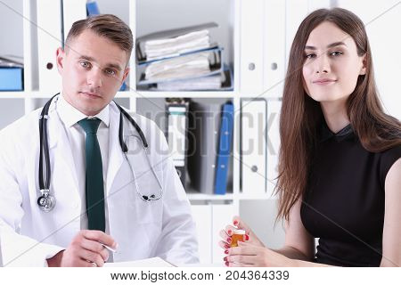 Handsome Male Doctor Explain Prescription