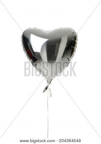 Single silver big heart metallic balloon for birthday isolated on a white background