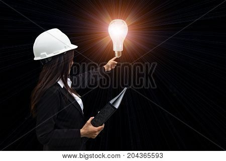 Creative ideas concept beautiful businesswoman holding glowing symbol.